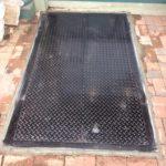 grated steel cellar door