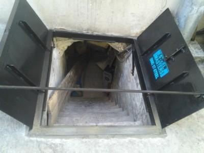 Sidewalk cellar door open