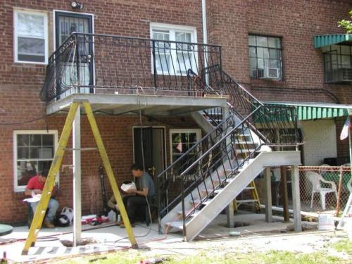 Galvanized open tread staircase and deck porch